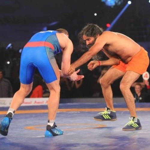 Baba Ramdev beats Olympic medalist in promotional PWL bout