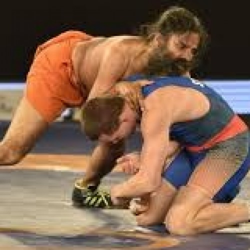 Watch Baba Ramdev wrestle and beat an Olympic silver medalist